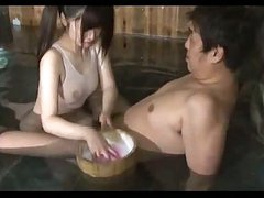 Oriental Girl In Swimsuit Giving Oral-stimulation In The Bath