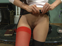 Hawt gal with red nylons in her fur pie doing impure things with her sex toy