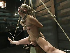Chastity Lynn is a blonde milf who enjoys being fastened up with ropes. That babe can't live without when that babe is not able to move her hands and feet freely. As that babe stands helpless with a ball gag in her face hole and a rope blindfold on her eyes, a friend is giving her a large time pleasure, rubbing her cunt with a vibrator.