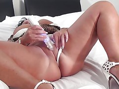 Cindy may not have a gorgeous face but she surely compensates with her huge boobs. This plump bitch desires a penis in her cunt and throat as she puts the sex tool betwixt her jugs and sucks it then uses it to masturbate.