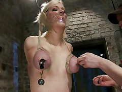 Golden-haired wench with large breasts, high heels and long sexy legs and a sexy camel toe is getting tied up and whipped. That chick has duct tape on her mouth that chick that chick will shut up as that chick gets her harsh treatment. A women puts clamps on her hard nipps and whips the bitch hard on her horny face and squeezed milk sacks but especially on those clamps. I think this wench enjoys the pain and maybe that chick will get a lot more of it.