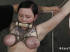 Doesn't she looks good bound in that position and mouth gagged? We don't want her screams disturbs the executor do we? She's a cutie and the way this man bound and squeezed her love muffins shows his experience. The man then inserted a fake penis attached at a stick that he bound with ropes, gorgeous ingenious!