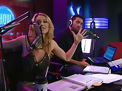 Playboy Radio's Morning Show has some of the hottest women you've ever seen! They're talking about Halloween costumes, and their guest has a cop outfit on that looks sexy as hell. It gets even sexier when her top comes off, baring her tits. The female host comes over and helps shorten the skirt.