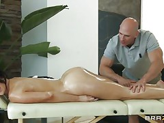 Look at this pretty brunette having a massage on her lengthy sexy legs and her sexy body. Just at the view of her moistured ass and her tight cookie that sweetheart acquires the guy all lustful and makes him want to give it to her deep. Do you think that sweetheart needs some spunk with all that oil or a large hard cock in her cunt?