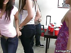 2 of the college sluts are showing their asses to the camera, then one of 'em is doing a lap dance to a guy. Like any party in college, the sweethearts are either flashing their bumpers or doing body shots. After drinking a lot of tequila, three sweethearts are having a threesome in front of their friends.