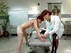 This is the kind of doc that you will barely await to see. She's a devilish redhead with a passion to dominated, especially other sluts! Her patient came for a routine check and found herself naked and wazoo slapped until that sexy wazoo turned red. Now that the doc slapped her she licks her booty with passion.