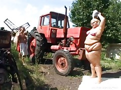 Melinda is so much woman this babe needs 2 men to fuck her. Tibor and Gabor lift up her chubby folds and widen her ass cheeks. The both suck on her biggest melons outside by the tractor. The rubs each part of her big chubby pretty body.
