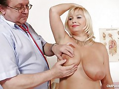 This blonde floozy is totally naked at the doctor. The doctor begins examining her large breasts with large and sexy nipples. After that that guy takes her pulse. The mature women is sitting on the bed now with her large a-hole at the doctor. That guy start inspects her a-hole and large shaved love tunnel from behind.
