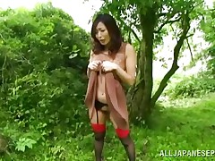 Nature loving Nippon cutie is receiving her dose of wilderness! This cute bitch has her hands bound on a tree branch and receives roughly fucked from behind. Her moans and screams won't help her because there's nobody around. Look at that sweet wet crack being rubbed with a vibrator and then fucked hard.