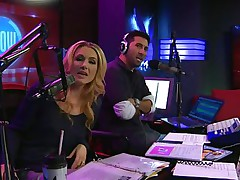 The hosts of Playboy Radio's Morning Show are looking at their guest model who is wearing the suit she'll be wearing to the Playboy Mansion for Halloween. Her head and tits are overspread in fake fruit like oranges, limes, lemons, and more. She flashes her titties for the hosts and viewers.