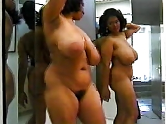 Black woman with excellent body dancing in mirror