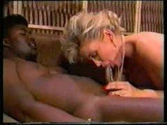 2 black guys fuck white floozy in classic video