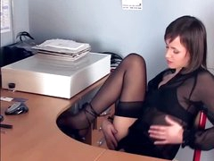 Dark brown hair masturbates in sheer stockings and heels